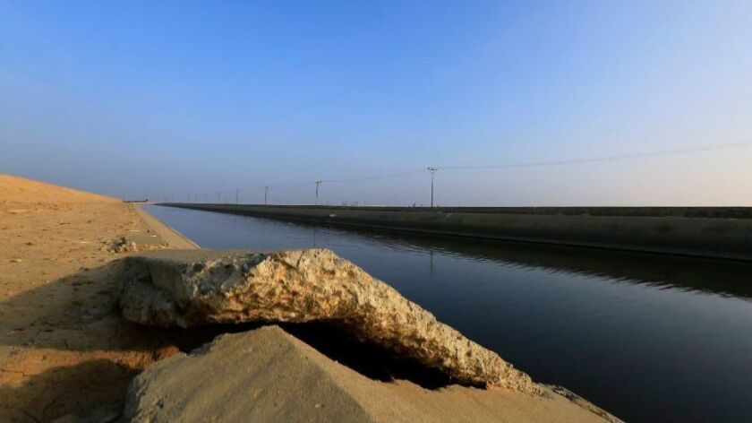 Buckled concrete sits along the Delta Mendota Canal on Jan. 13, 2015, near Los Banos. The ground is sinking due to overpumping groundwater in the San Joaquin Valley.