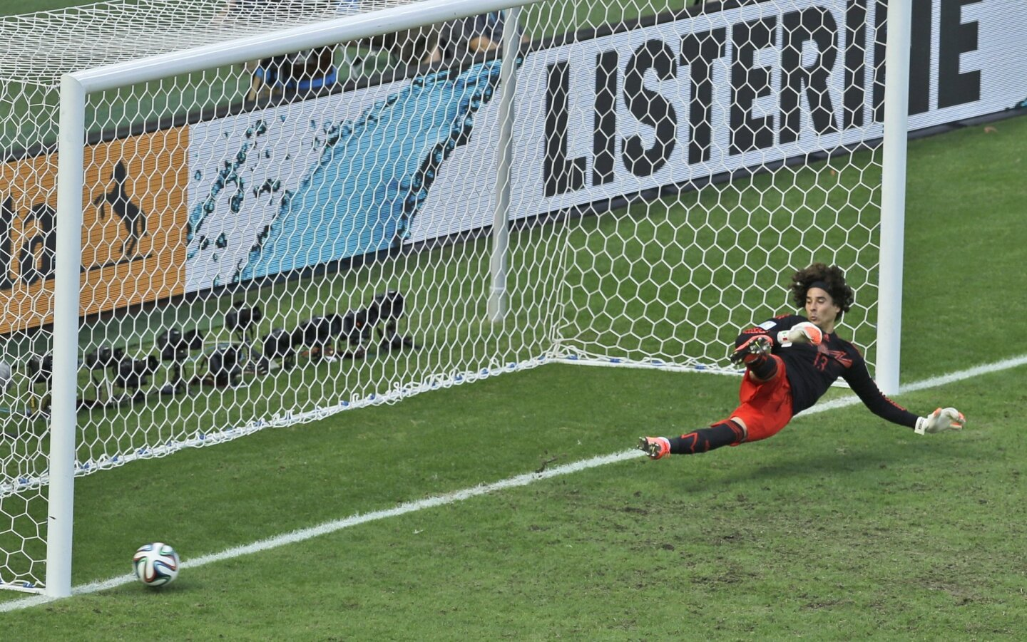 Mexico's goalkeeper Guillermo Ochoa fails to save a shot by Netherlands' Klaas-Jan Huntelaar from the penalty spot during the World Cup round of 16 soccer match between the Netherlands and Mexico at the Arena Castelao in Fortaleza, Brazil, Sunday, June 29, 2014. Holland won 2-1 and advanced to the