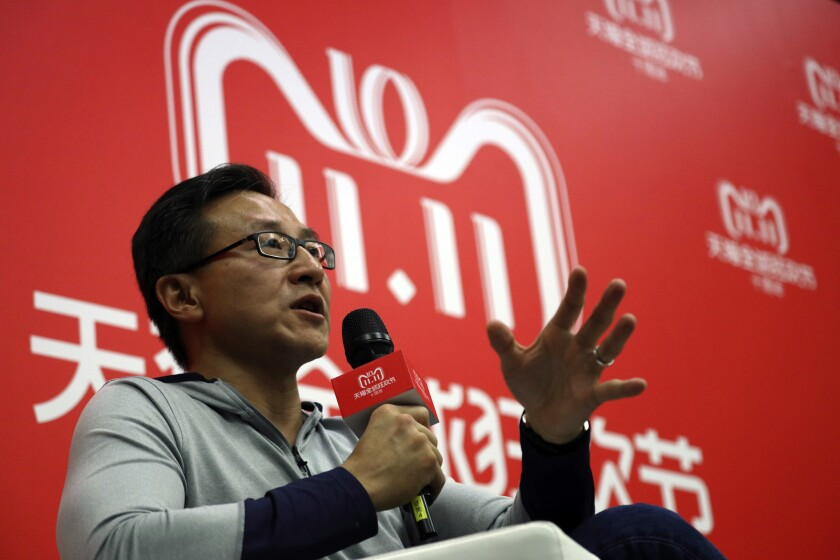 Joe Tsai, executive vice chairman of Alibaba Group, speaks to journalists during Alibaba's 11.11 Global Shopping Festival, also known as Singles Day in Shanghai, China, in 2018.