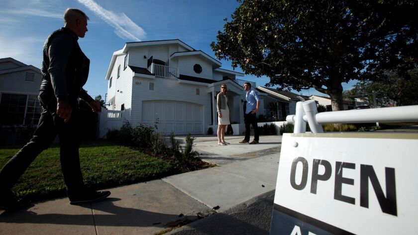 WESTCHESTER, CA - DECEMBER 14, 2014 -- Prospective home buyers Theresa and Dustin Dobson wait for th
