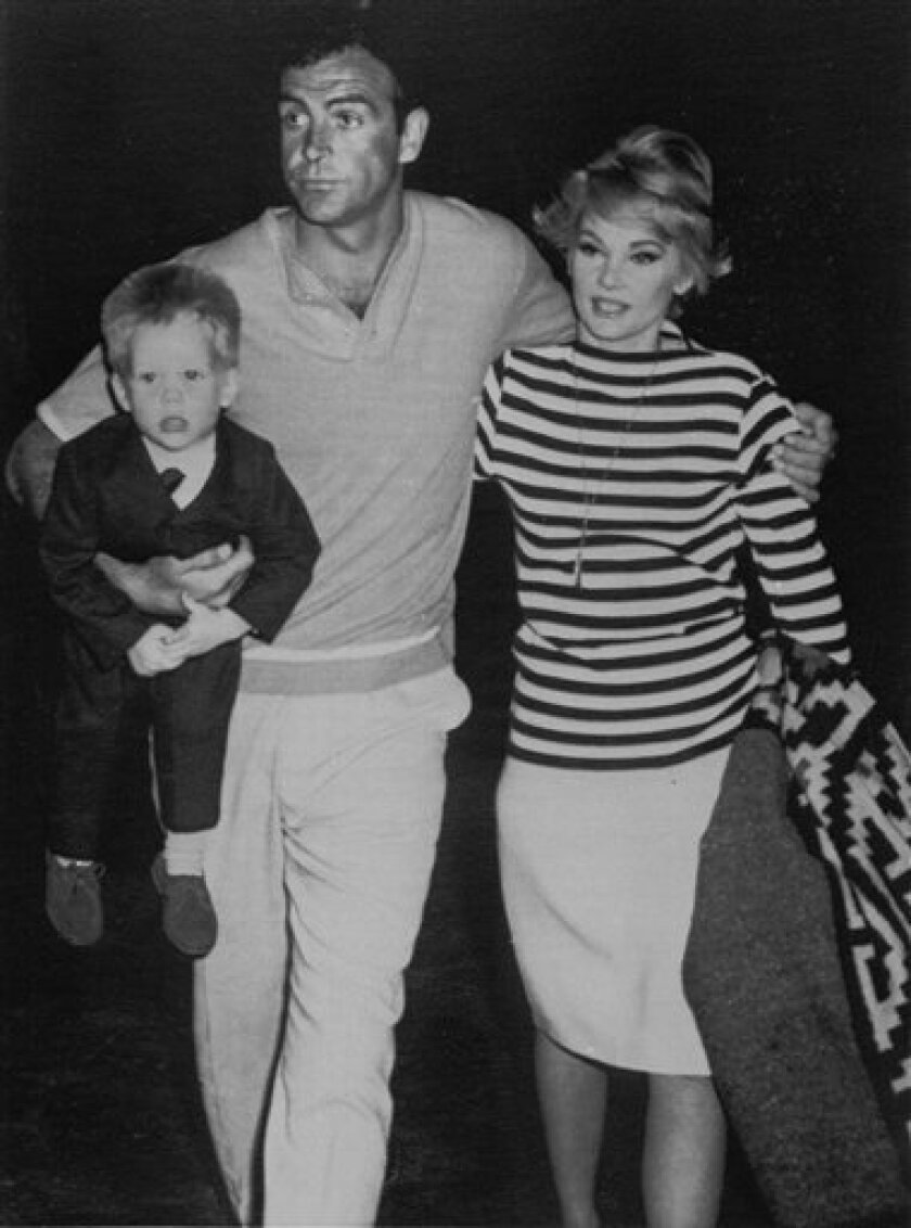 FILE - In this April 14, 1965 file photo, actor Sean Connery, holding son Jason under his arm, and wife Diane Cilento walk away from plane after her arrival at Nassau, Bahamas April 14, 1965. Oscar-nominated Australian actress Diane Cilento has died Thursday, Oct. 6, 2011, in northern Australia at age 78. (AP Photo/File)