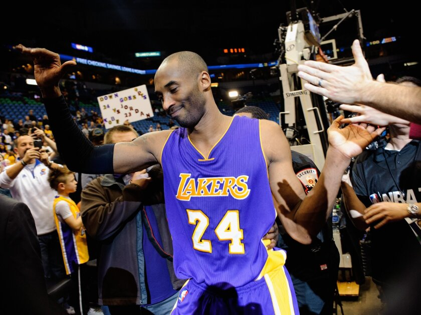 """Kobe Bryant, pictured in December 2014, created the book """"The Wizenard Series: Season One,"""" which was released last week, about two months after his death."""