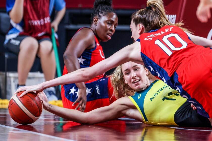 USA forward Breanna Stewart (10) dives over Team Australia power forward Alanna Smith (11) for a loose ball
