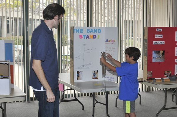 Jack demonstrates his invention as teacher Tim Miller looks on