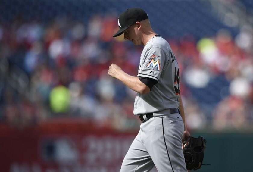 Miami Marlins relief pitcher Scott McGough walks to the dugout.