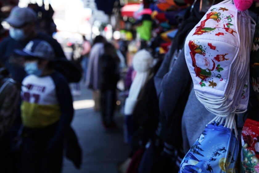 Masks are sold in downtown Los Angeles on Tuesday, the same day California extended regional stay-at-home orders.
