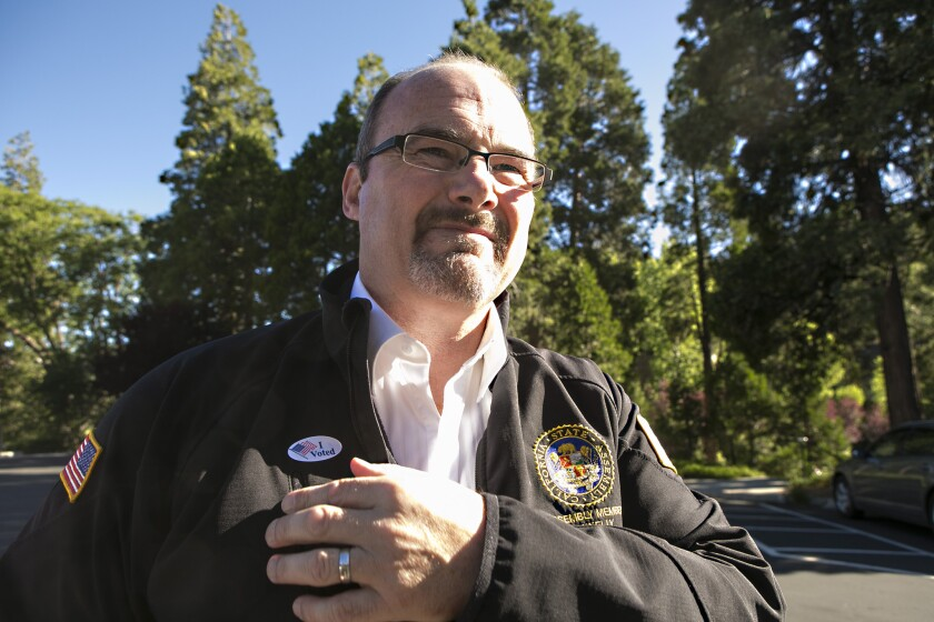 Tim Donnelly leaves the polling place at Lake Arrowhead Country Club after casting his vote in June 2014 during his unsuccessful bid for governor. On Wednesday, Donnelly filed a proposed referendum to place California's new vaccination law before voters.