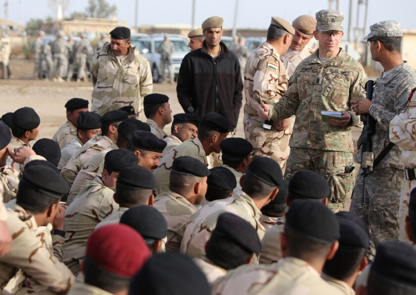 Command Sergeant Major Tony Grinston speaks to Iraqi soldiers at the Taji base complex, which is located north of Baghdad.