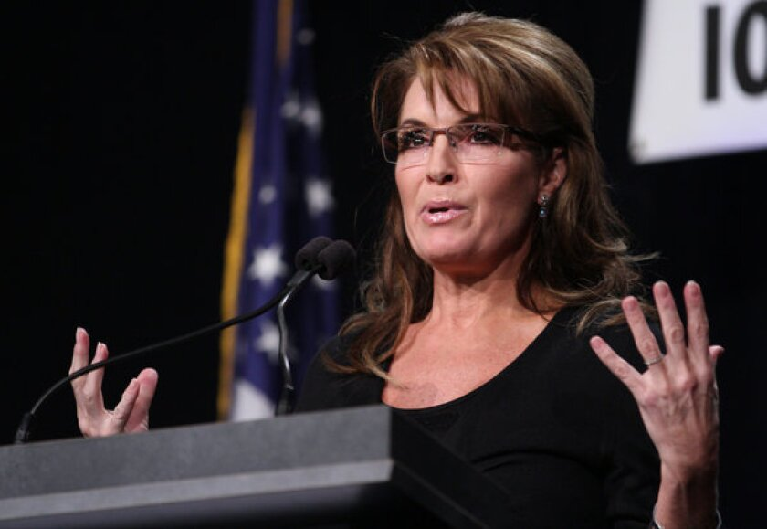 Former Alaska Gov. Sarah Palin speaks during the Iowa Faith & Freedom Coalition's Friends of the Family Banquet in Des Moines, Iowa, on Nov. 9.