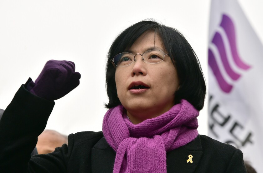 After a ruling banning her party, Lee Jung-hee, leader of South Korea's Unified Progressive Party, chants outside the Constitutional Court in Seoul on Dec. 19.