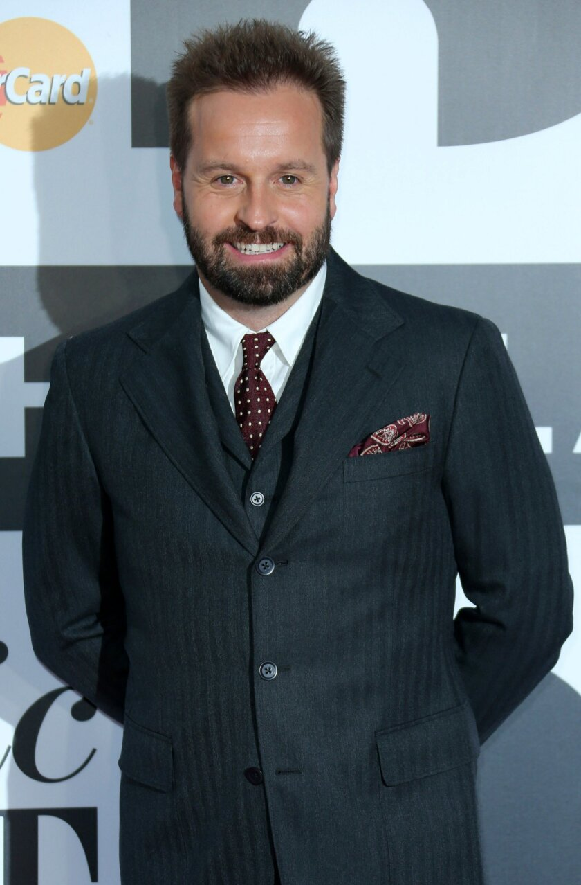 """FILE - In this Oct. 2, 2013 file photo, English tenor Alfie Boe arrives for the Classic BRIT Awards in London. Boe will go from prisoner to playwright when he trades in """"Les Miserables"""" for """"Finding Neverland"""" late next month on Broadway. The British tenor, who has been playing Jean Valjean, will start as """"Peter Pan"""" creator J.M. Barrie on March 29, 2016 at the Lunt-Fontanne Theatre, replacing Tony Yazbeck in the role, who finishes his run two night earlier. . (Photo by Joel Ryan/Invision/AP, File)"""