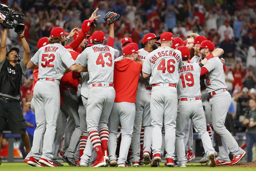 The St. Louis Cardinals celebrate their 13-1 win over the Atlanta Braves in Game 5 of the NLDS on Wednesday in Atlanta.