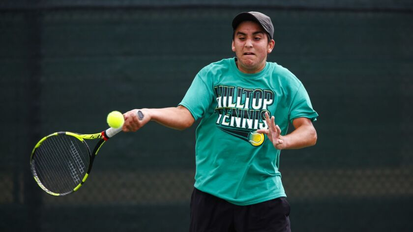 Hilltop's Ivan Smith hits a forehand in the San Diego Section singles final.
