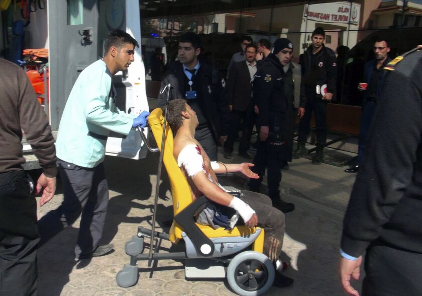 A Syrian man who was wounded at a blast in al-Bab, a town in northern Syria, is wheeled into a hospital in Kilis, Turkey, on Feb. 24, 2017. A car bomb went off Friday north of the town that was controlled by Islamic State militants since late 2013 and was just captured by Turkish forces and Syrian opposition fighters.