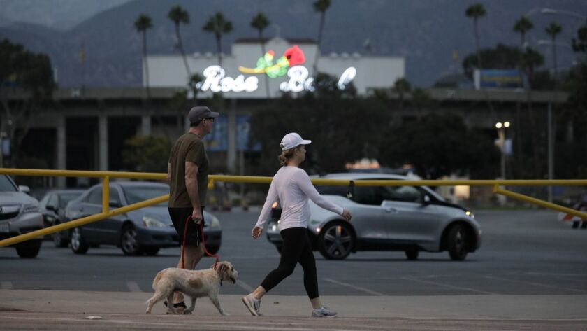 Police blocked the road around parking lot K where a man was stabbed and found dead at the Rose Bowl