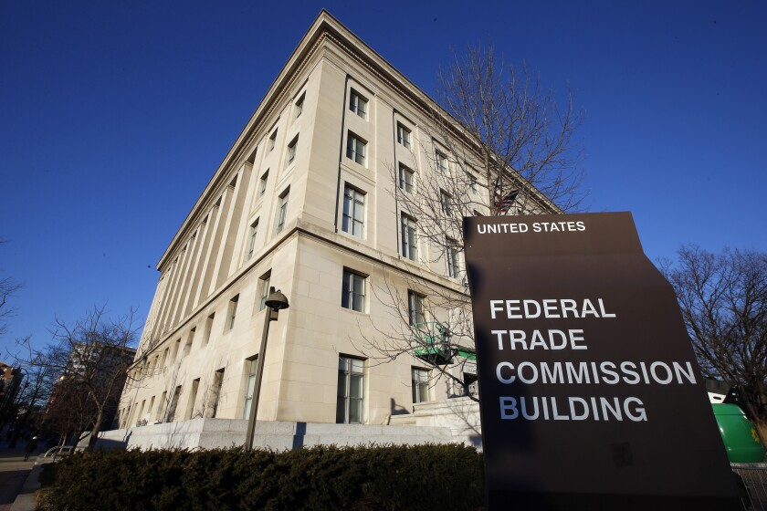 """FILE - This Jan. 28, 2015, file photo, shows the Federal Trade Commission building in Washington. Federal regulators say they are cracking down on """"an explosion"""" of businesses' use of fake reviews and other misleading messages to promote their products and services on social media. The Federal Trade Commission said, Thursday, Oct. 14, 2021, it has warned hundreds of major corporations and smaller businesses that they could face fines if they use bogus endorsements to deceive consumers. (AP Photo/Alex Brandon, File)"""