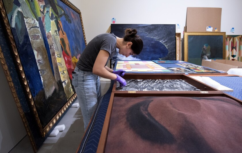 The Buck collection is cleaned, photographed, and readied for exhibit at the Contemporary Arts Cente