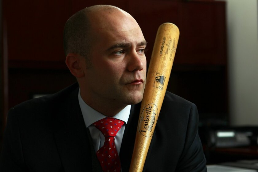 Former Marine Capt. Alexander Martin keeps a baseball bat in the office as a reminder that no matter how stressful business gets, it's nothing compared with war.