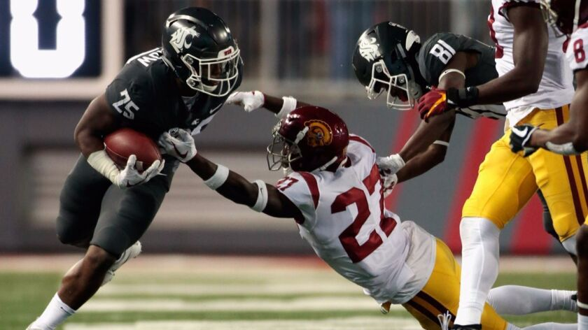 Washington State's Jamal Morrow (25) carries the ball against USC's Aiene Harris (27) in the second half on Sept. 29. Washington State defeated USC 30-27.