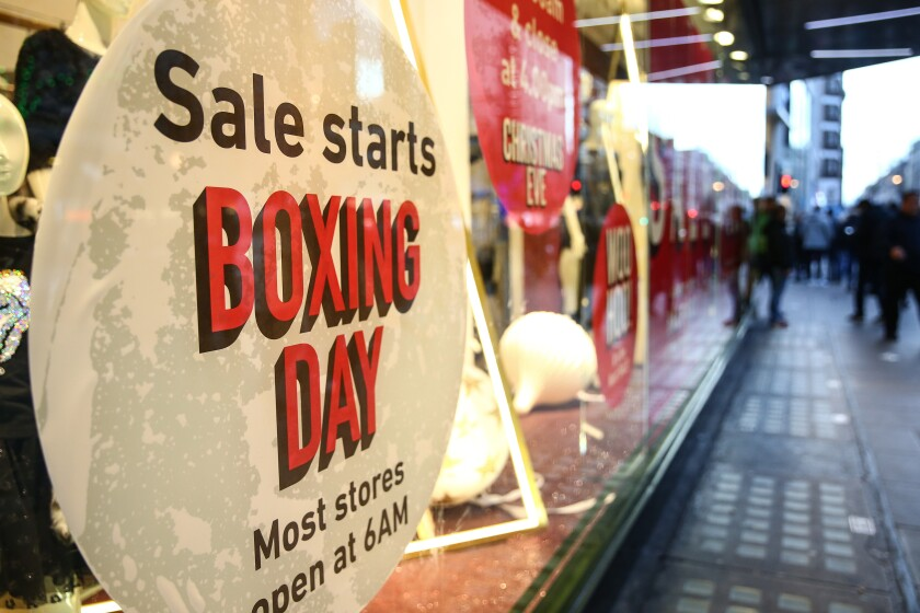 Boxing Day sale signs are posted on Oxford Street in London.