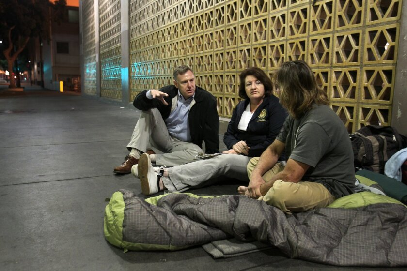 "Assembly member Toni Atkins, center, and Rep. Scott Peters, left, talk with a homeless man early Friday morning in downtown San Diego during the ""We All Count"" census of the homeless in the county."