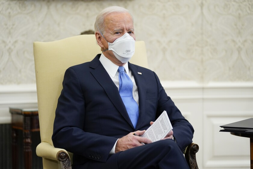 President Joe Biden speaks during a meeting with a bipartisan group of mayors and governors to discuss a coronavirus relief package, in the Oval Office of the White House, Friday, Feb. 12, 2021, in Washington. (AP Photo/Evan Vucci)