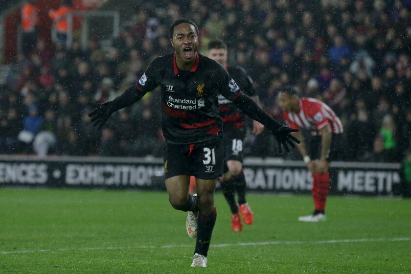 Liverpool's Raheem Sterling celebrates after scoring a goal during the English Premier League soccer match between Southampton and Liverpool at St Mary's Stadium, Southampton, England, Sunday, Feb. 22, 2015. (AP Photo/Tim Ireland)
