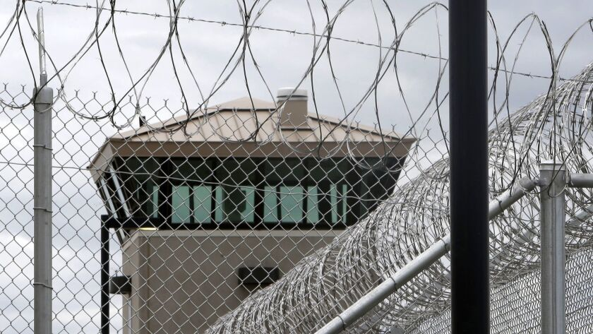 File-This June 25, 2013 file photo shows a guard tower over the fence surrounding the new California