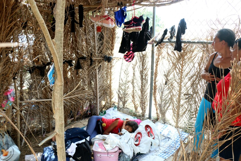 Migrants from recent caravan of mostly Central Americans taking shelter at makeshift dwelling at a
