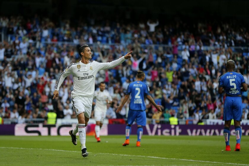 Real Madrid's Cristiano Ronaldo celebrates after scoring a goal during a Spanish La Liga soccer match between Real Madrid and Getafe at the Santiago Bernabeu stadium in Madrid, Spain, Saturday, May 23, 2015. (AP Photo/Daniel Ochoa de Olza)