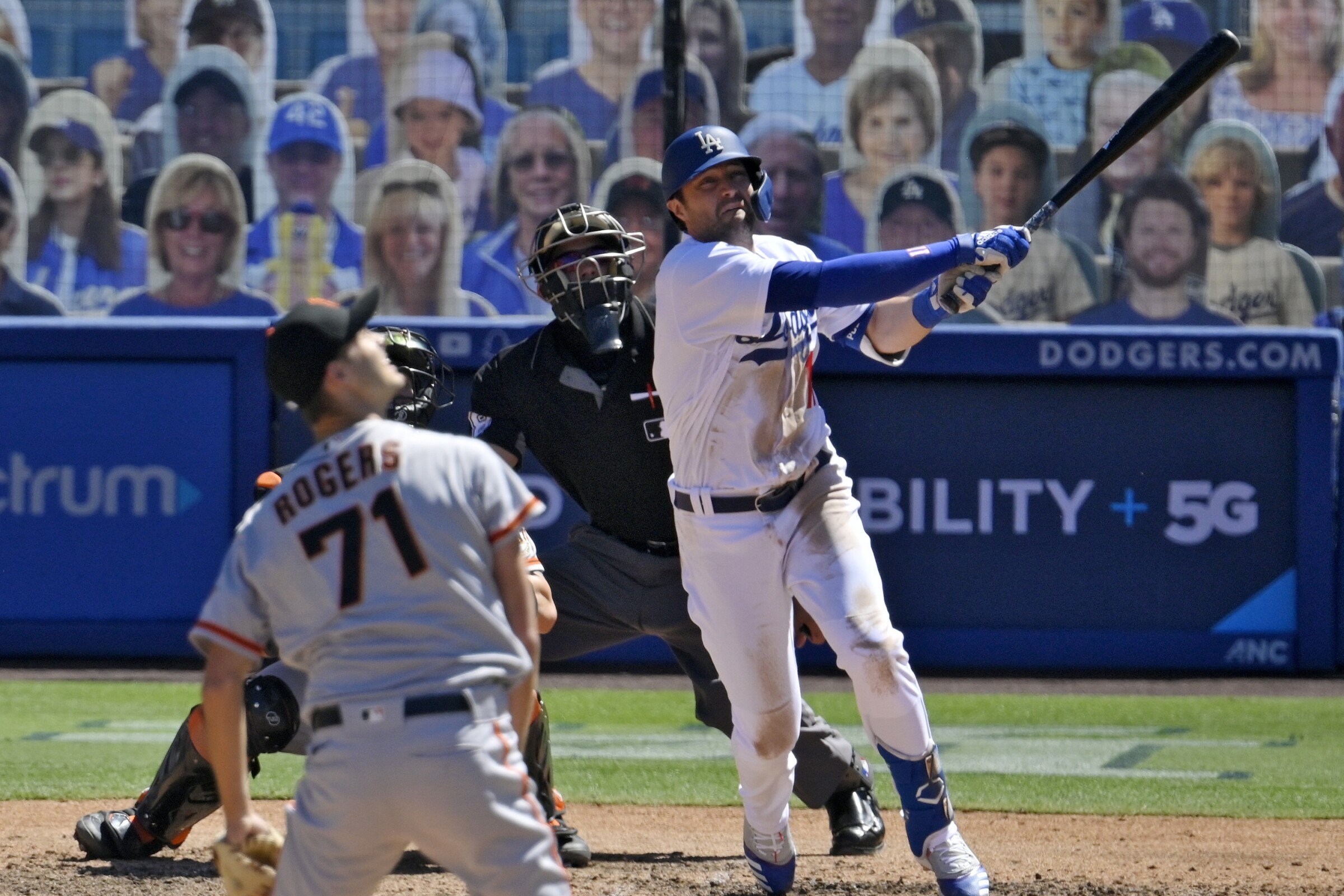Dodgers' AJ Pollock watches his three-run home run off San Francisco Giants relief pitcher Tyler Rogers.