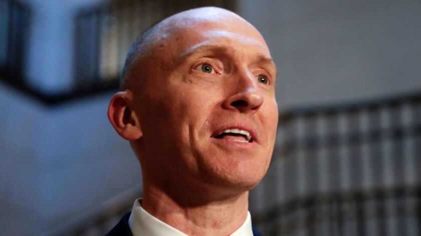 Carter Page, a foreign policy advisor to Donald Trump's 2016 presidential campaign, speaks with a reporter on Capitol Hill on Nov. 2, 2017.