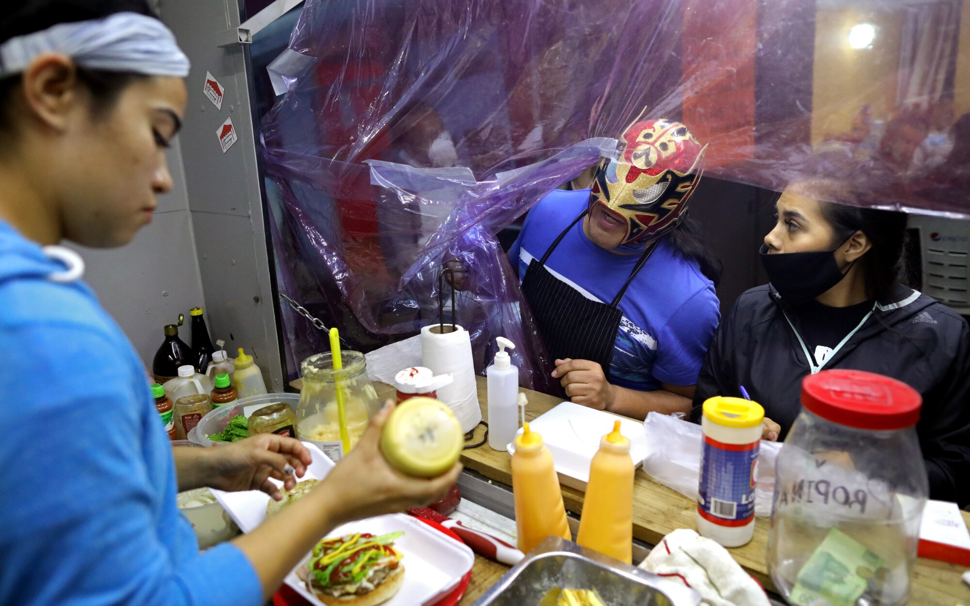 "Professional wrestler Jose Gutierrez Hernandez, 48, ""El Ultimo Guerrero,"" at De Otro Nivel food truck in Mexico City"