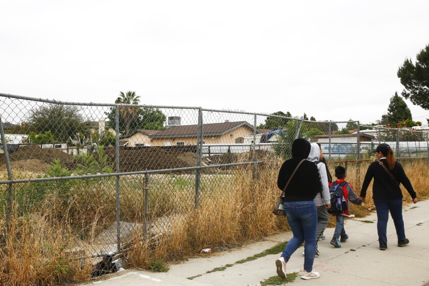 PANRAMA CITY, CALIF. - MAY 08: People walk by the property that is at the heart of the Richard Alarc