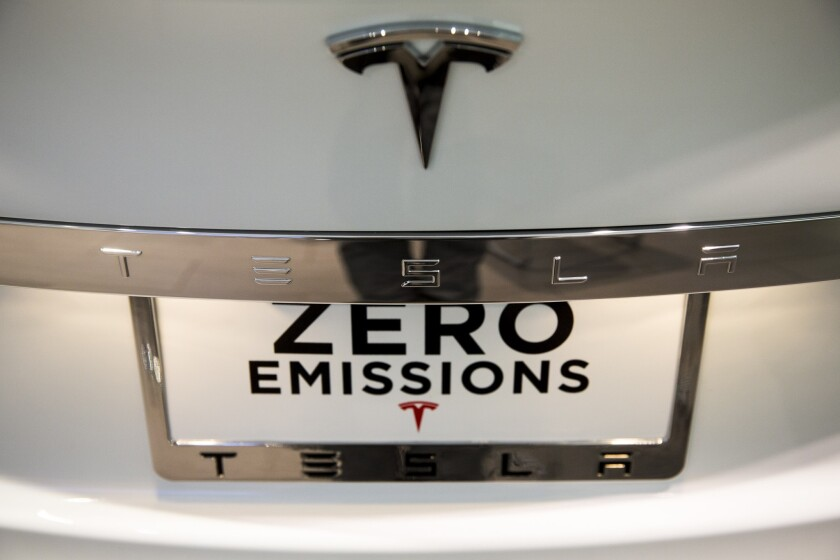 A detail of the rear end emblem of a Tesla Model S at the electric automaker's Santa Monica showroom.