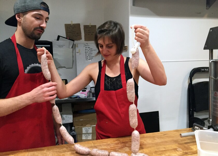 Heart & Trotter sausage-making instructor Joey Parks weighs in on student Alejandra Klorig's finished product.