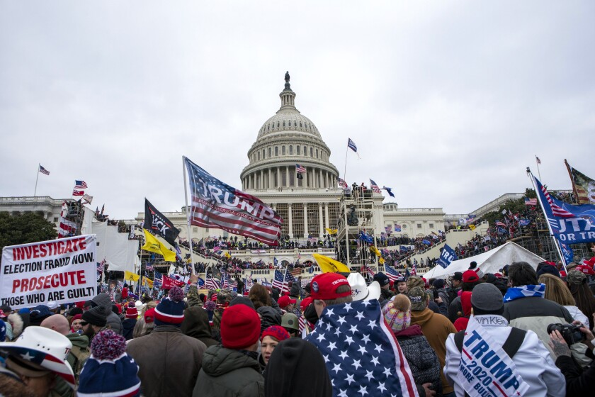 Trump supporters mass outside the U.S. Capitol on the day of the riot