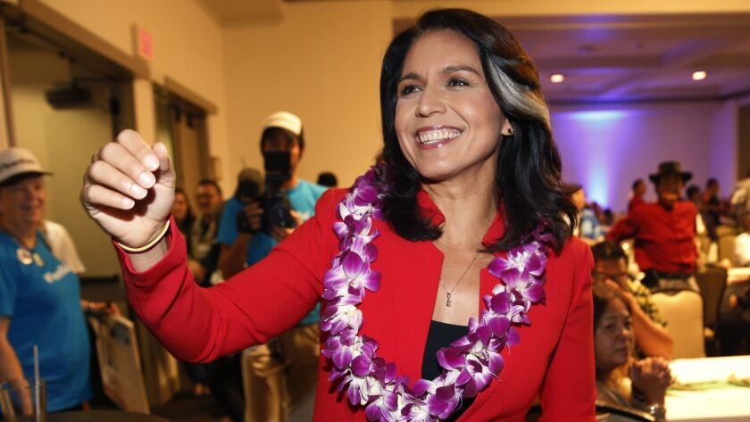 FILE - In this Nov. 6, 2018, file photo, Rep. Tulsi Gabbard, D-Hawaii, greets supporters in Honolulu