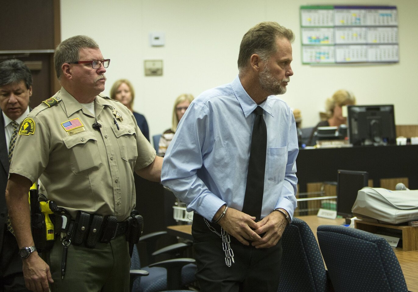 Charles Merritt is led out of the courtroom after his arraignment, where he pleaded not guilty in the slayings of the McStay family.