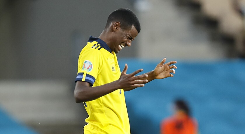 Sweden's Alexander Isak reacts after he missed to score during the Euro 2020 soccer championship group E match between Spain and Sweden in Sevilla, Spain, Monday, June 14, 2021. (Jose Manuel Vidal/Pool via AP)