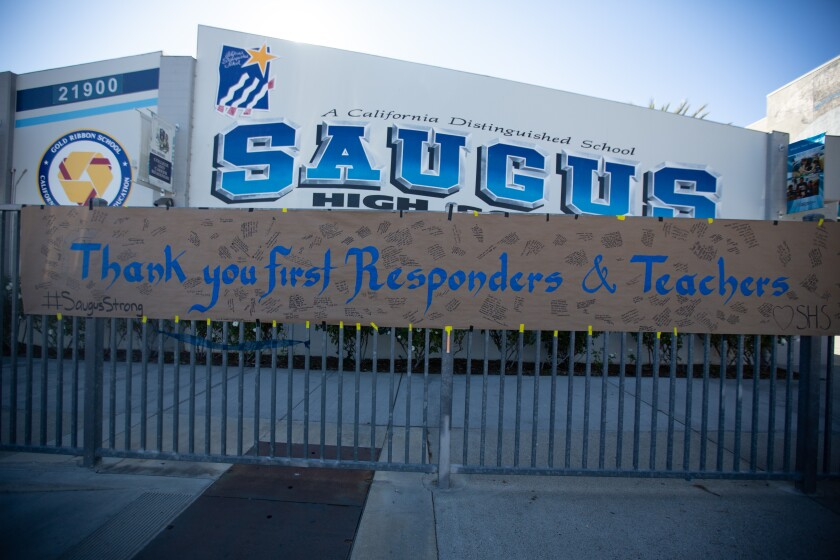 A banner hanging outside Saugus High School thanks first responders and teachers on Nov. 18, 2019.