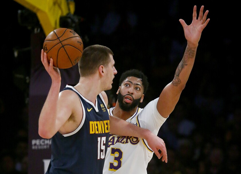 Lakers forward Anthony Davis defends Nuggets center Nikola Jokic during a game Dec. 22, 2019, at Staples Center.