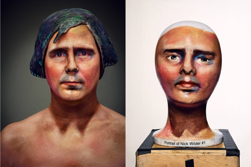 At right, a bust, left, a man painted like the bust