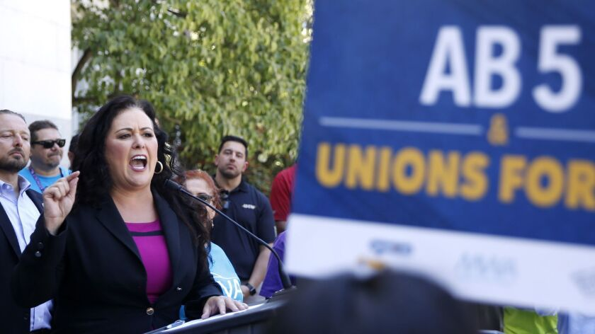 Assemblywoman Lorena Gonzalez (D-San Diego) speaks at a rally after her measure to limit when companies can label workers as independent contractors was approved by a Senate committee July 10.