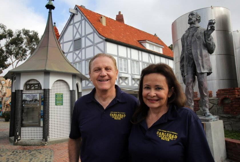 Ludvik and Veronica Grigoras outside their mineral water spa at Alt Karlsbad.