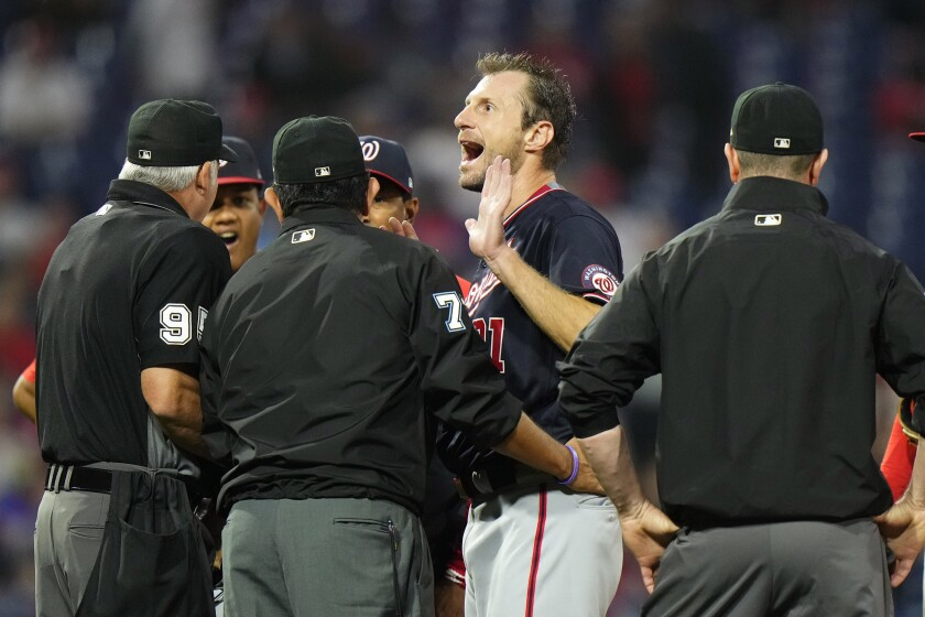Washington Nationals pitcher Max Scherzer reacts as he talks with umpires during a foreign substances check in the middle of the fourth inning of a baseball game against the Philadelphia Phillies, Tuesday, June 22, 2021, in Philadelphia. (AP Photo/Matt Slocum)