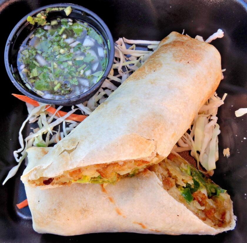 Bennett Wok N Tandoor To The Rescue In O C Los Angeles Times