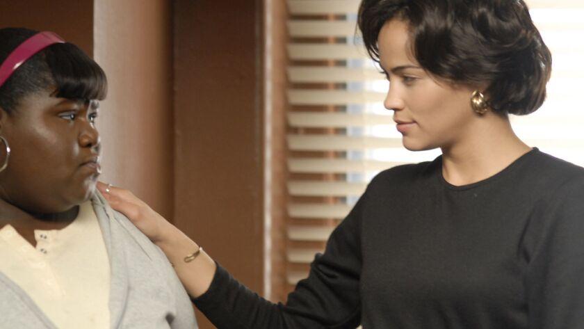 Precious (Gabourey Sidibe, left) and Ms. Rain (Paula Patton, right) in the movie PRECIOUS: BASED ON