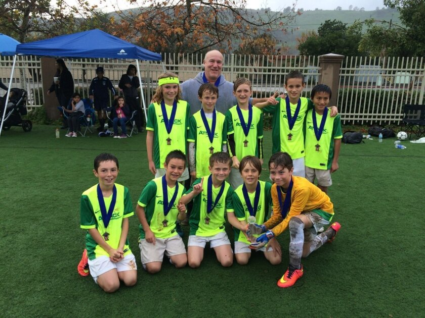 The Rancho Santa Fe Attack Boys U10 White Team played in the CPL Soccer Tournament in San Juan Capistrano over the weekend. After four games played in the rain and mud, they brought home a trophy for their division.