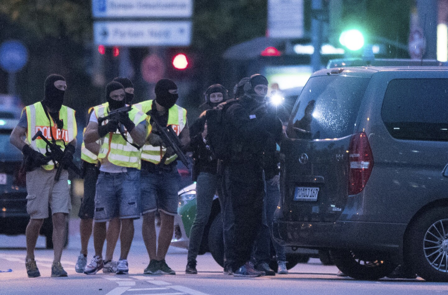People leave the Olympia mall in Munich after several people were killed in a shooting.